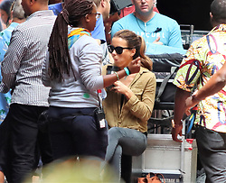 Kate Beckinsale shooting The Widow in Cape Town centre. She takes a break from shooting, sat on the back of a trolly eating her lunch.