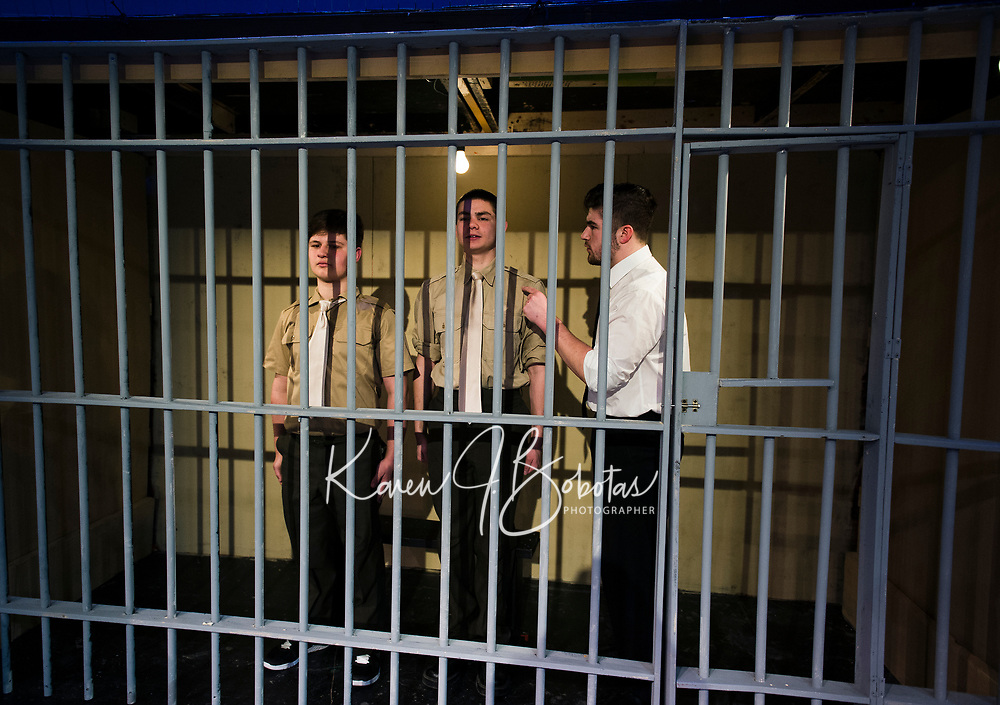 "Jonathan Buttrick PFC Louden Downey and Josh Testa Lance CPL Harold W. Dawson are questioned by Lt. Daniel Kaffee during dress rehearsal for ""A Few Good Men"" at Gilford High School Monday afternoon.  (Karen Bobotas/for the Laconia Daily Sun)"