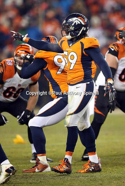 Denver Broncos inside linebacker Danny Trevathan (59) points during the 2015 NFL week 16 regular season football game against the Cincinnati Bengals on Monday, Dec. 28, 2015 in Denver. The Broncos won the game in overtime 20-17. (©Paul Anthony Spinelli)