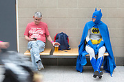 UNITED KINGDOM, London: 25 May 2019 <br /> A cosplayer dressed as Batman sits and waits for a friend on the final day of MCM London Comic Con. Thousands of cosplay enthusiasts will come to the ExCeL Centre this weekend to enjoy the convention.