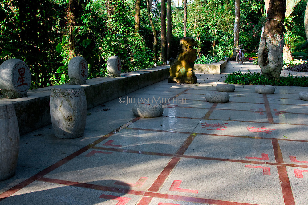 Giant outdoor Chinese Chess board in the meticulously maintained grounds of the Guangxi Medicinal Herb Botanical Garden.