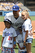 LOS ANGELES, CA - JUNE 15:  Jamey Wright #28 of the Los Angeles Dodgers poses for a photo with his children before the Father's Day game against the Arizona Diamondbacks at Dodger Stadium on Sunday, June 15, 2014 in Los Angeles, California. The Diamondbacks won the game 6-3. (Photo by Paul Spinelli/MLB Photos via Getty Images) *** Local Caption *** Jamey Wright