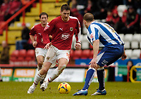 Photo: Leigh Quinnell.<br /> Bristol City v Huddersfield Town. Coca Cola League 1. 10/02/2007. Bristol Citys Phil Jevons looks to pass Huddersfields David Mirfin.