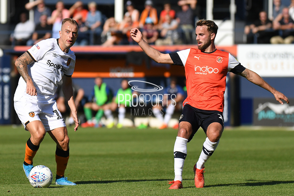 Hull City midfielder Kamil Grosicki (11) looks for options under pressure from Luton Town midfielder Andrew Shinnie (11) during the EFL Sky Bet Championship match between Luton Town and Hull City at Kenilworth Road, Luton, England on 21 September 2019.