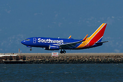 Boeing 737-7Q8 (N7876A) operated by Southwest Airlines landing at San Francisco International Airport (KSFO), San Francisco, California, United States of America