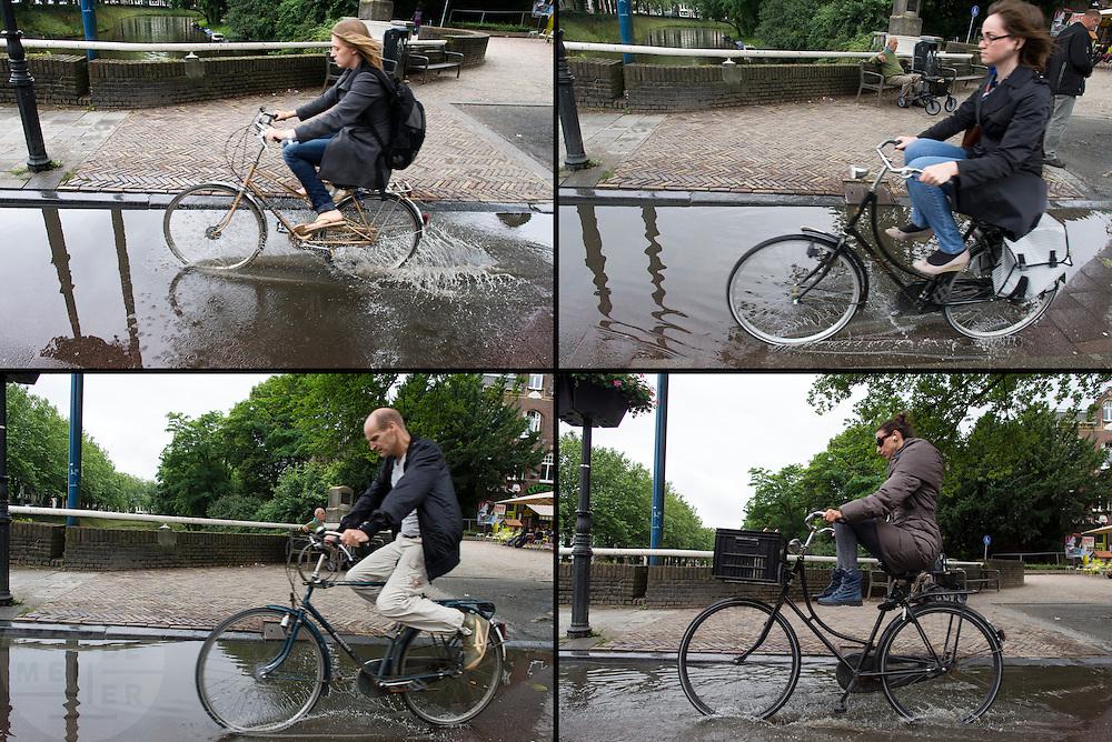 Fietsers trekken hun benen op om hun voeten droog te houden als ze door een plas moeten rijden.<br /> <br /> Cyclists are holding their legs up to keep their feet dry as they have to cycle through a puddle.