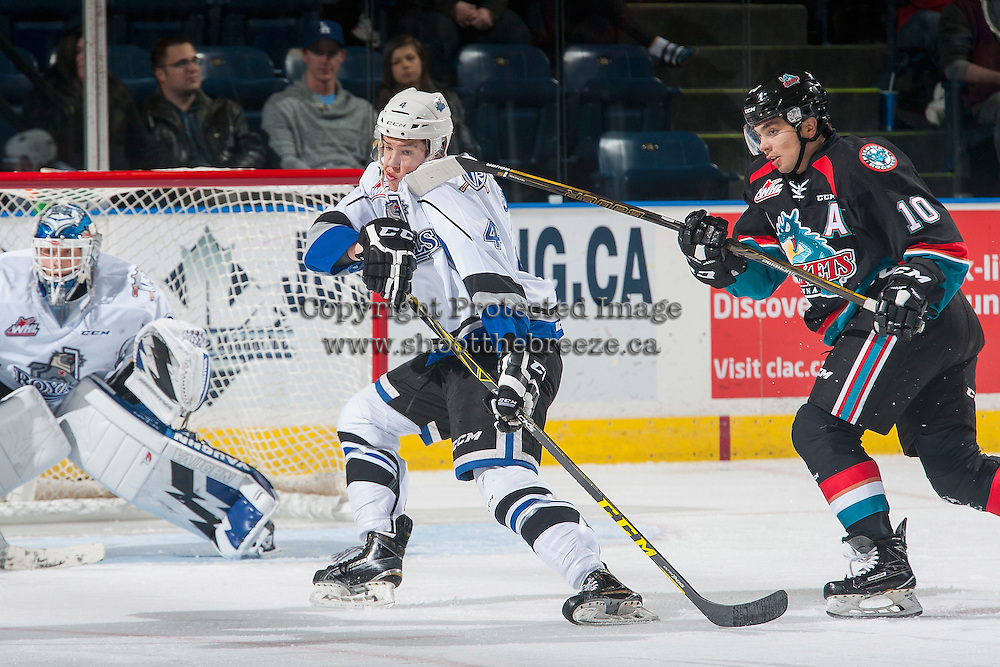 KELOWNA, CANADA - OCTOBER 26: Ralph Jarratt #4 of the Victoria Royals dodges a high stick by Nick Merkley #10 of the Kelowna Rockets during first period on October 26, 2016 at Prospera Place in Kelowna, British Columbia, Canada.  (Photo by Marissa Baecker/Shoot the Breeze)  *** Local Caption ***