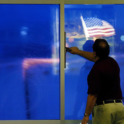 Kyle Green | The Roanoke Times<br />November 21, 2005 Roanoke Regional Airport Commission Custodian, Tim Koch, cleans windows at the Roanoke Regional Airport early Monday morning.