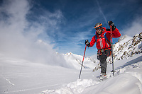 A male mountaineer as seen walking on a deep powder snow on a cold Winter day on Glacier Blanc in Mont Blanc Massif.
