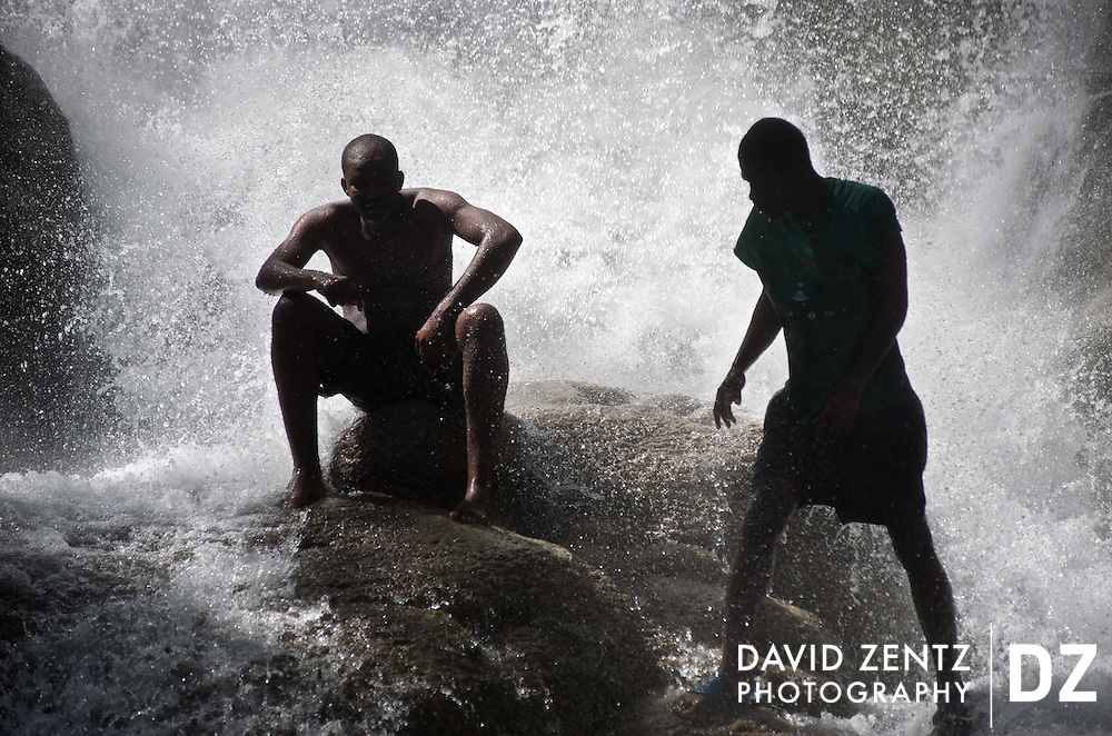 Pilgrims soak themselves in the waters of Saut D'eau during the annual 3-day voodoo pilgrimage held in the remote Haitian village on July 14, 2008.