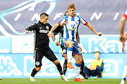 Wigan Athletic midfielder Michael Jacobs (17) steals the ball from Brighton & Hove Albion winger Anthony Knockaert (11) during the EFL Sky Bet Championship match between Wigan Athletic and Brighton and Hove Albion at the DW Stadium, Wigan, England on 22 October 2016.