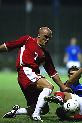 NOVI SAD, SERBIA -Tuesday, August 19th, 2003: Wales' David Pipen is tackled by Serbia & Montenegro's Nikola Mijailovic in action against Serbia & Montenegro during the UEFA Under 21 European Championship Group 9 Qualifying match at the Karadorde Stadium. (Pic by David Rawcliffe/Propaganda)