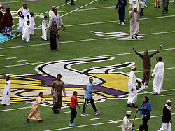 A celebrant has his photo taken near the Vikings logo Tuesday, August 21, 2018, at U.S. Bank Stadium in Minneapolis, MN, USA, tocelebrate Eid ul-Adha, the organization Super Eid hopes to bring together over 50,000 Muslims to pray. Photo by David Joles/Minneapolis Star Tribune/TNS/ABACAPRESS.COM