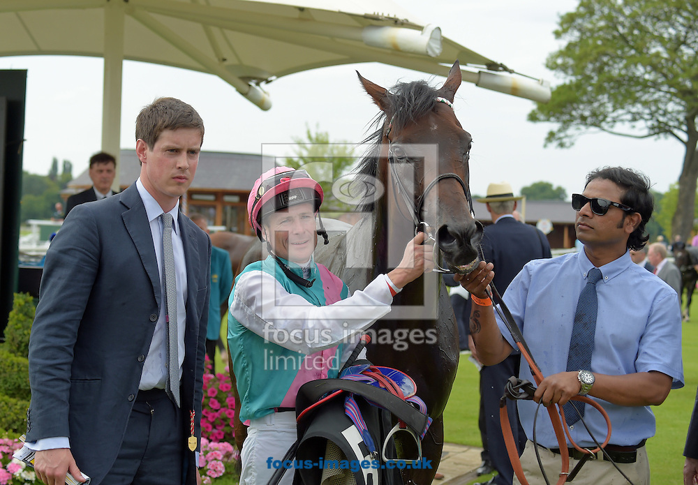 Time Test ridden by Pat Smullen (green with pink sash and white sleeves) after winning Sky Bet York Stakes during the Sky Bet York Stakes meeting at York Racecourse, Yorkshire, UK.<br /> Picture by Martin Lynch/Focus Images Ltd 07501333150<br /> 23/07/2016