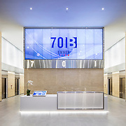 The Hollander Design Group has updated a 1980s era Ware Malcomb high-rise lobby with a light, high-key palette.