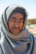 Teenage Ethiopian boy, Coptic Christian with facial tattoo.