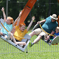 Lucy, 5, and Samuel, 8, Eddington enjoy one of the many rides at Saturday's Freedom Fest in New Albany