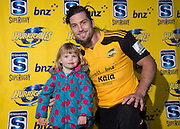 Hurricanes Cory Jane with Kaia Prince as Hurricanes players are presented their BNZ Future Stars playing shirts for the charity Plunket. Hurricanes Super Rugby Media and Training Session at Rugby Park on Thursday the 22nd of May 2014. Photo by MartyMelville/www.Photosport.co.nz