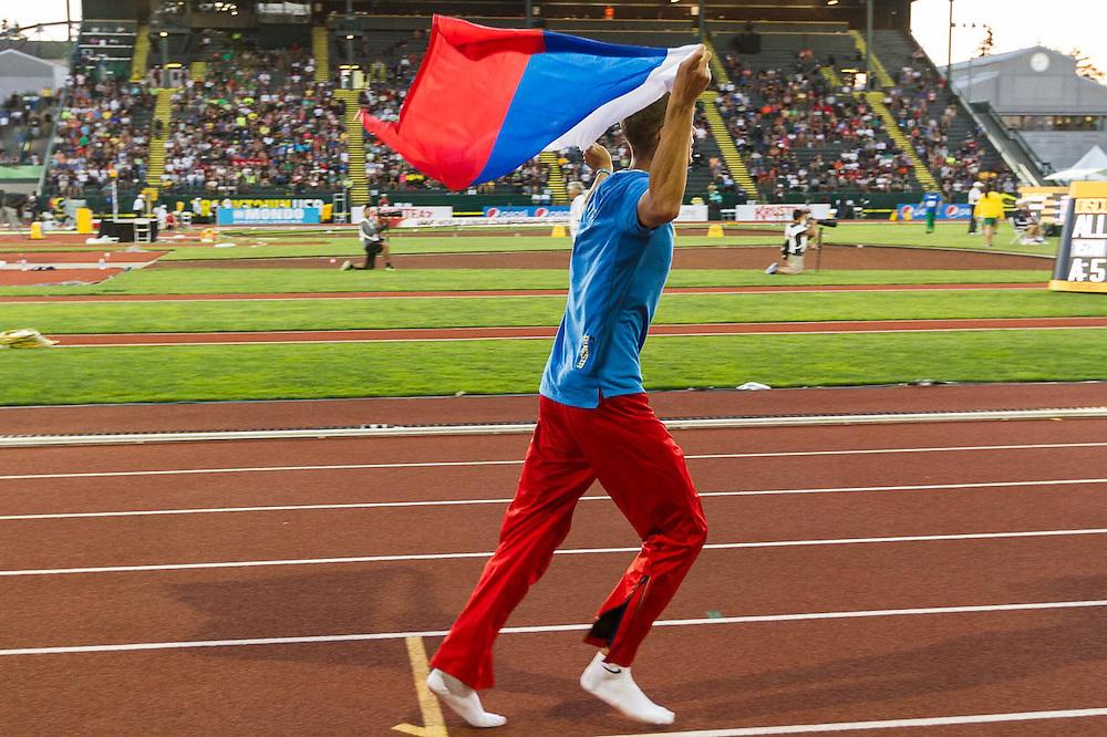 mens high jump, winner Mikhail Akimenko, Russia, victory lap