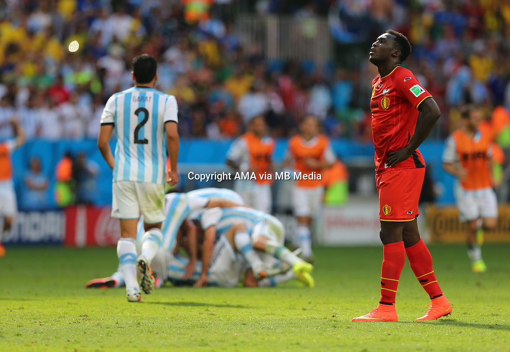 A dejected Romelu Lukaku of Belgium at the end of the match as Argentina celebrate earning a place in the semi final