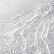 Snow textures and tracks on mountain summit Montagne des Allebasses