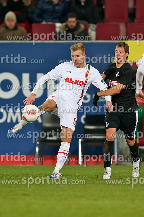 01.12.2012, SGL Arena, Augsburg, GER, 1. FBL, FC Augsburg vs SC Freiburg, 15. Runde, im Bild Zweikampf zwischen Ragnar KLAVAN (# 5, FC Augsburg) und Anton Putsila (# 14, SC Freiburg) v.l // during the German Bundesliga 15th round match between FC Augsburg and SC Freiburg at the SGL Arena, Augsburg, Germany on 2012/12/01. EXPA Pictures © 2012, PhotoCredit: EXPA/ Eibner/ Peter Fast..***** ATTENTION - OUT OF GER *****