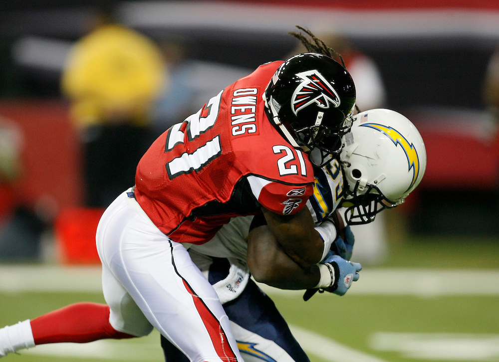 ATLANTA - AUGUST 29:  Cornerback Christopher Owens #21 of the Atlanta Falcons tackles running back Gartrell Johnson #33 of the San Diego Chargers during the game at the Georgia Dome on August 29, 2009 in Atlanta, Georgia.  The Falcons beat the Chargers 27-24.  (Photo by Mike Zarrilli/Getty Images)
