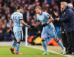 Manchester City's Sergio Aguero is replaced by Manchester City's Edin Dzeko   - Photo mandatory by-line: Matt McNulty/JMP - Mobile: 07966 386802 - 04/03/2015 - SPORT - football - Manchester - Etihad Stadium - Manchester City v Leicester City - Barclays Premier League