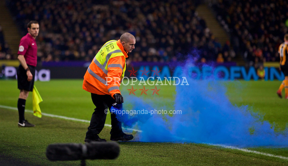 KINGSTON-UPON-HULL, ENGLAND - Friday, December 30, 2016: A steward removes a blue smoke bomb after it was thrown onto the pitch as Everton supporters celebrate their second equalising goal against Everton during the FA Premier League match at the KCOM Stadium. (Pic by David Rawcliffe/Propaganda)