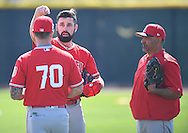 Angels' pitcher Matt Shoemaker talk with Tom Gregorio, left, and Steve Soliz about his protective hat insert before facing live BP during workouts at the Angels' Spring Training facility in Tempe, AZ on Wednesday, February 22, 2017. (Photo by Kevin Sullivan, Orange County Register/SCNG)