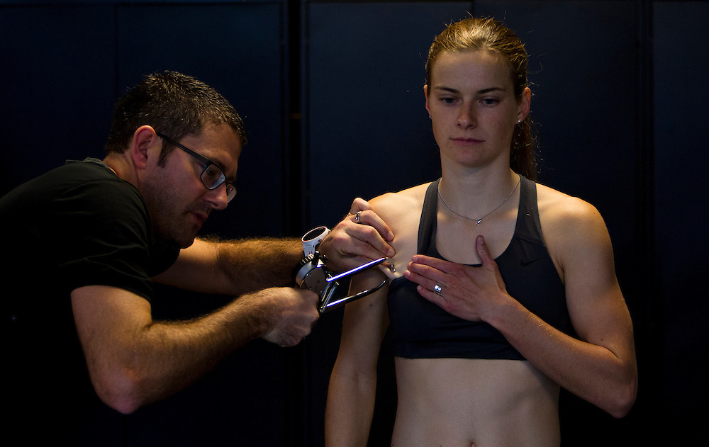 Trent Stellingwerff, applied sport physiologist with a specialization in performance nutrition performs anthropometric measurements on Casey Atkin at the Pacific Institute for Sport Excellence on December 3rd 2015 in Victoria, British Columbia Canada.