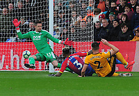 Football - 2018 / 2019 Premier League - Crystal Palace vs. Wolverhampton Wanderers<br /> <br /> Matt Doherty of Wolves scores his goal past the diving Wayne Hennessey, at Selhurst Park.<br /> <br /> COLORSPORT/ANDREW COWIE