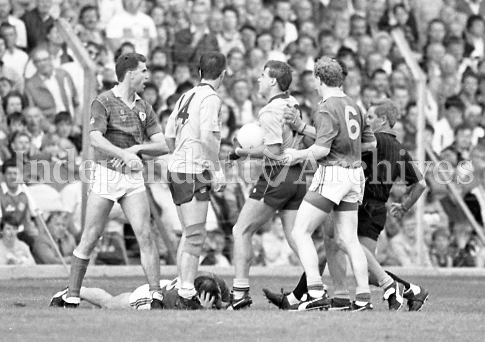 790-630<br /> Leinster Football Final at Croke Park, Dublin v Meath, 29th July 1990:<br /> Action on the pitch with one player on the ground.<br /> Meath 1-14 Dublin 0-14<br /> Pic: Dara Mac Donaill, 29/7/90<br /> (Part of the Independent Newspapers Ireland/NLI Collection)