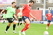Joe Tait of York City (5) defends the ball during the Vanarama National League North match between York City and Curzon Ashton at Bootham Crescent, York, England on 18 August 2018.