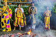 01 OCTOBER 2014 - BANGKOK, THAILAND: Firewalkers pray near the fire pit at Wat Yannawa (also spelled Yan Nawa) during the Vegetarian Festival in Bangkok. The Vegetarian Festival is celebrated throughout Thailand. It is the Thai version of the The Nine Emperor Gods Festival, a nine-day Taoist celebration beginning on the eve of 9th lunar month of the Chinese calendar. During a period of nine days, those who are participating in the festival dress all in white and abstain from eating meat, poultry, seafood, and dairy products. Vendors and proprietors of restaurants indicate that vegetarian food is for sale by putting a yellow flag out with Thai characters for meatless written on it in red.     PHOTO BY JACK KURTZ