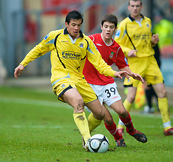 WREXHAM, WALES - Saturday, February 14, 2009: Wrexham's Ryan Flynn, on loan from Liverpool, in action against Grays Athletic's Rob Gier during the Blue Square Premier League match at the Racecourse Ground. (Mandatory credit: David Rawcliffe/Propaganda)