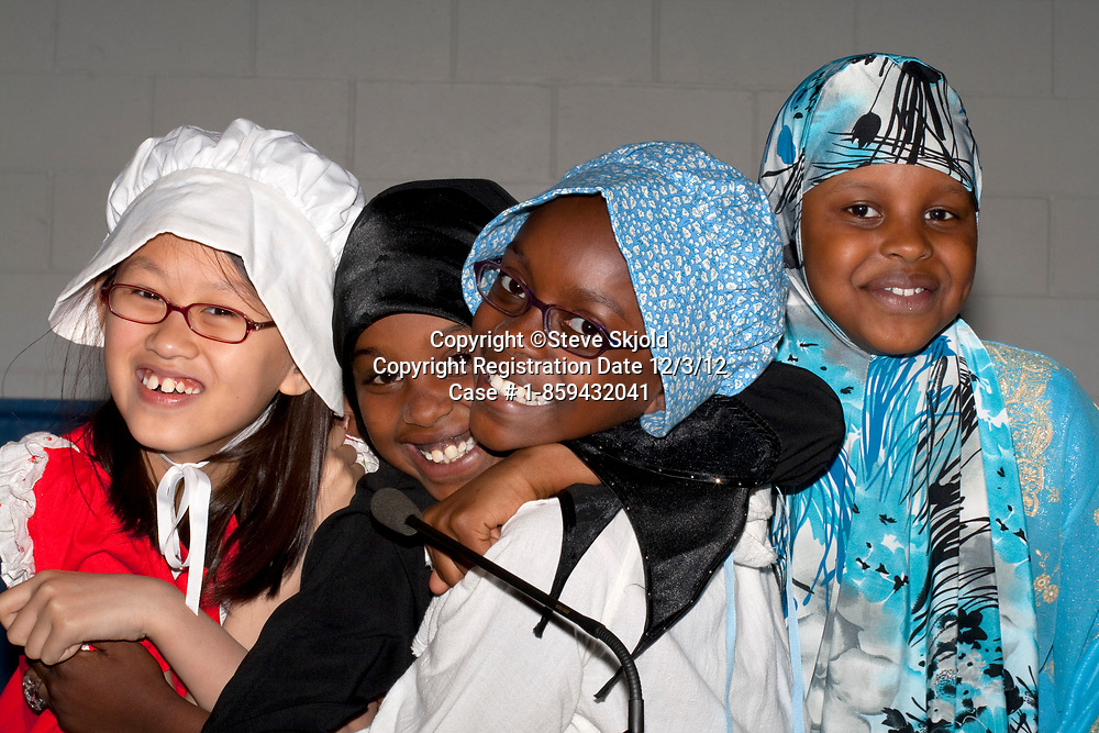 Fun loving Muslim and white students portraying the early days of Minnesota life. Horace Mann School. St Paul Minnesota MN USA