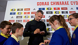 BARRY, WALES - Thursday, October 3, 2019: Wales manager Ryan Giggs signs autographs for school children from Ysgol Gymraeg after a press conference to announce his squad for the forthcoming UEFA Euro 2020 Qualifying Group E qualifying matches against Slovakia and Croatia. (Pic by David Rawcliffe/Propaganda)