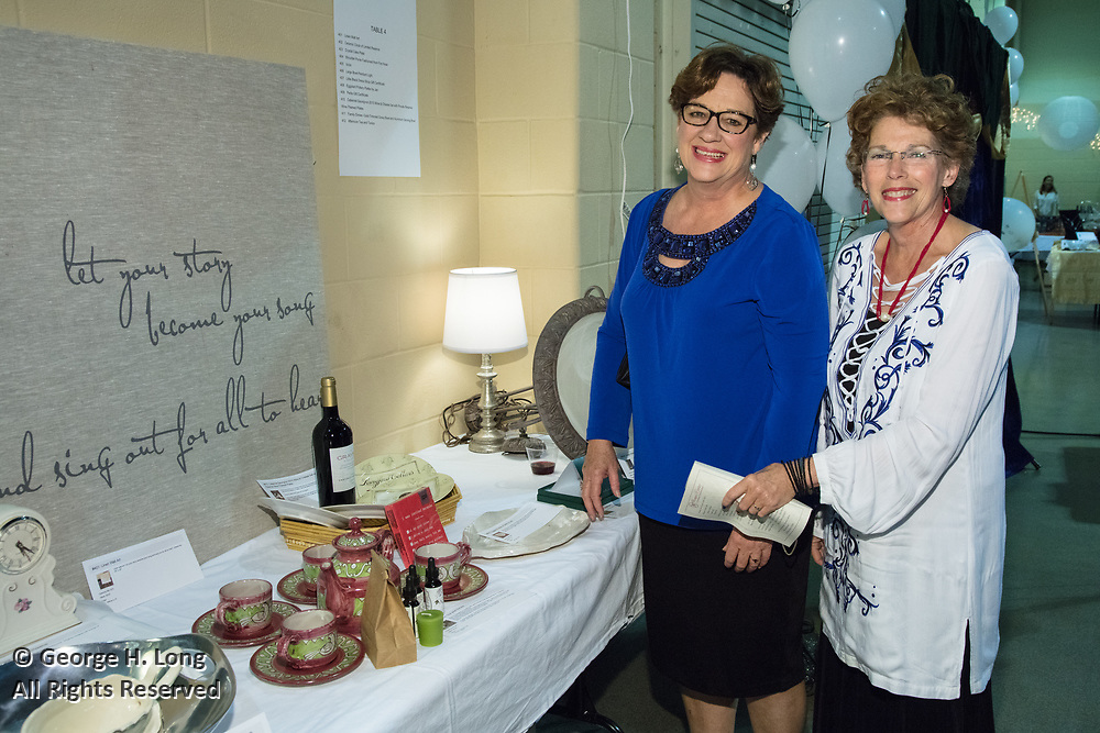 """Marian Roper and Angelique LaCour; The Women's Center for Healing and Transformation """"An Evening of Masquerade"""" fifth annual fundraising gala at the Castine Center in Mandeville, Louisiana on March 31, 2017"""