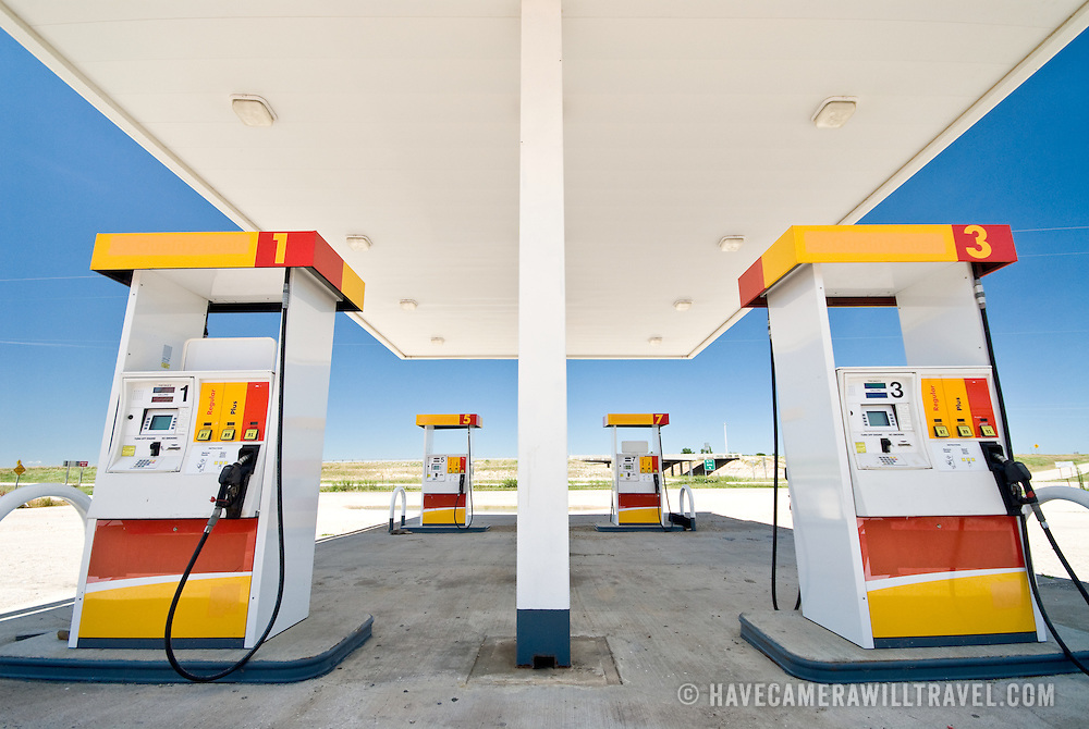 An empty gas (petrol) station with four pumps
