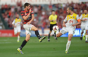 20.10.2013 Sydney, Australia. Wanderers forward Tomi Juric and Wellingtons captain and defender Andrew Durante  in action during the Hyundai A League game between Western Sydney Wanderers FC and Wellington Phoenix FC from the Pirtek Stadium, Parramatta. The game ended in a 1-1 draw.