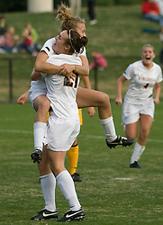 Virginia midfielder/defender Nikki Krzysik (23) and Virginia forward Meghan Lenczyk (21) celebrate after Kryzsik scored the game winning goal in the 89th minute.  The Virginia Cavaliers defeated the William and Mary Tribe 1-0 in the second round of the NCAA Women's Soccer tournament held at Klockner Stadium in Charlottesville, VA on November 18, 2007.