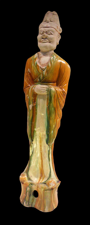 Tang Dynasty, Chinese 7th = 8th century AD glazed earthenware figure. The figure depicts a dignitary, possibly a court official.