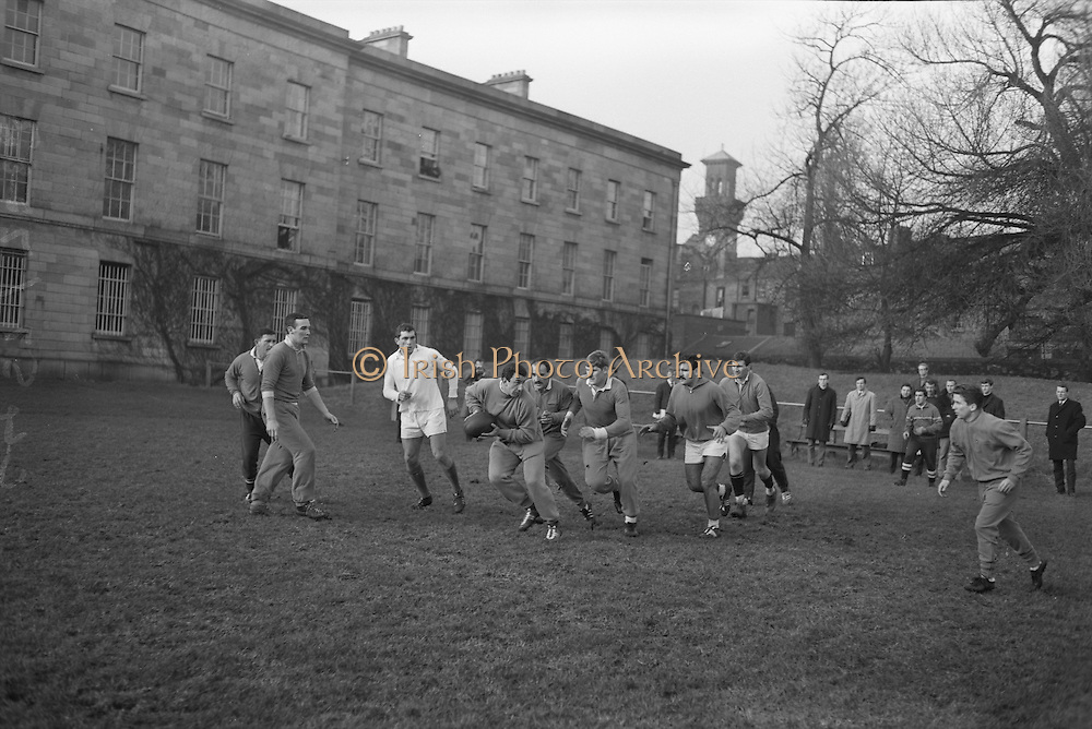 Jackues Berejnoi, prop forward, passes with, left-right, Dauga, Crauste, Captain, and Spanghero in pursuit,..Irish Rugby Football Union, Ireland v France, Five Nations, French team practice at College Park, Dublin, Ireland, Friday 22rd January, 1965,.22.1.1965, 1.22.1965,..Referee- D G Walters, Welsh Rugby Union, ..Score- Ireland 3 - 3 France, ..French Team, ..P Dedieu, Wearing number 15 French jersey, Full Back, A S Biterroise Rugby Football Club, France,. .J Gachassin, Wearing number 11 French jersey, Left Wing, F.C Lourdais Rugby Football Club, France, ..G Boniface, Wearing number 12 French jersey, Left Centre, Stade Montois Rugby Football Club, France,..J Pique, Wearing number 13 French jersey, Right Centre, S Paloise Rugby Football Club, France,..C Darrouy, Wearing number 14 French jersey, Right Wing, Stade Montois Rugby Football Club, France,..J Capdouze, Wearing number 10 French jersey, Stand Off, S Paloise Rugby Football Club, France,..L Camberabero, Wearing number 9 French jersey, Scrum Half, La Voulte Sportif Rugby Football Club, France,..J Berejnoi, Wearing number 1 French jersey, Forward, S C Tulliste Rugby Football Club, France,..J Cabanier, Wearing number 2 French jersey, Forward, U S Montalbanaise Rugby Football Club, France,..A Gruarin, Wearing number 3 French jersey, Forward, R.C Toulonnais Rugby Football Club, France,..W Spanghero, Wearing number 4 French jersey, Forward, R.C Narbonnais Rugby Football Club, France,..D Dauga, Wearing number 5 French jersey, Forward, Stade Montois Rugby Football Club, France,..M Lira, Wearing number 6 French jersey, Forward, La Voulte Sportif Rugby Football Club, France,..A Herrero, Wearing number 8 French jersey, Forward, R.C Toulonnais Rugby Football Club, France,..M Crauste, Wearing number 7 French jersey, Captain of the French team, Forward, F.C Lourdais Rugby Football Club, France, .