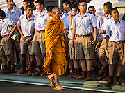 16 DECEMBER 2015 - BANGKOK, THAILAND:  A Buddhist monk walks up Krung Kasem Street to the funeral of Somdet Phra Nyanasamvara, who headed Thailand's order of Buddhist monks for more than two decades and was known as the Supreme Patriarch. He was ordained as a Buddhist monk in 1933 and appointed as the Supreme Patriarch in 1989. He was the spiritual advisor to Bhumibol Adulyadej, the King of Thailand when the King served as a monk in 1956. Tens of thousands of people lined the streets during the procession to pray for the Patriarch.    PHOTO BY JACK KURTZ
