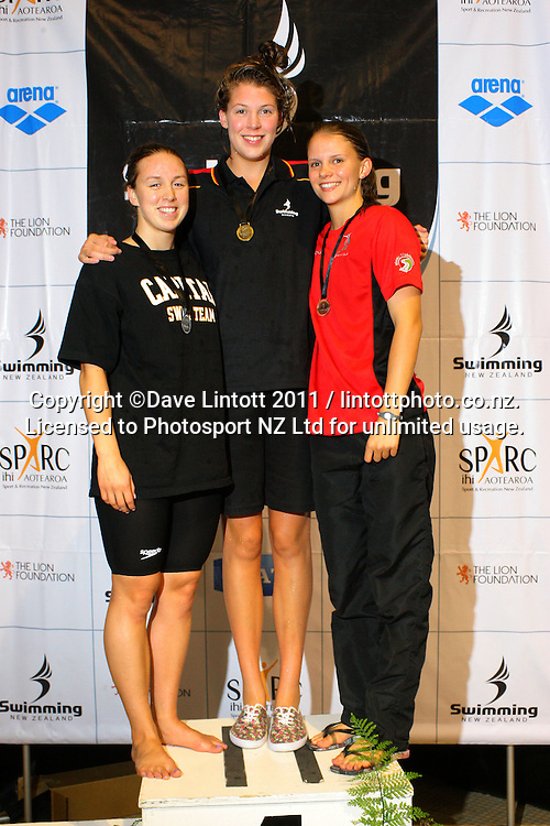 17-18yo Girls 200m medley podium, from left, Georgia Hind (2), Shelby Wilson (1) and Bianca Rowley (3). New Zealand Age Group Swimming Championships day five at Welllington Aquatics Centre, Kilbirnie, Wellington, New Zealand on Saturday, 5 March 2011. Photo: Dave Lintott / photosport.co.nz