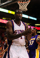 May 23, 2010; Phoenix, AZ, USA; Phoenix Suns forward Amare Stoudemire (1) reacts after making a point during the first quarter in game three of the western conference finals in the 2010 NBA Playoffs at US Airways Center.  Mandatory Credit: Jennifer Stewart-US PRESSWIRE