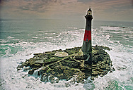 Dubh Artach lighthouse in the Irish Sea off the west coast of Scotland. Such isolated lighthouses were once manned by keepers. The Northern Lighthouse Board which operates Scotland's lighthouses, completed its programme of automation in the late 1990s.