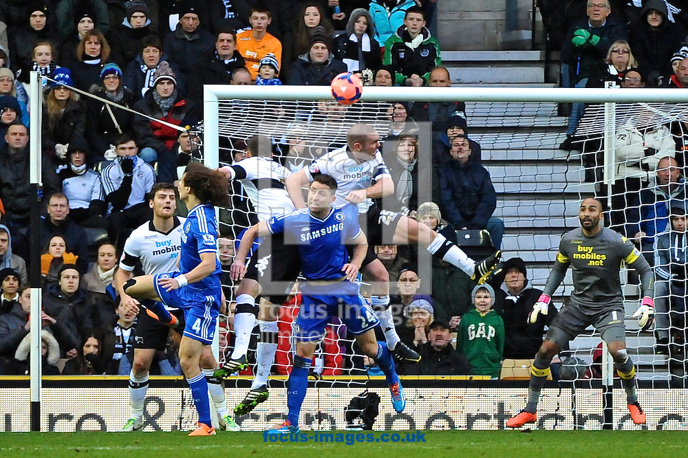 Picture by Ian Wadkins/Focus Images Ltd +44 7877 568959<br /> 05/01/2014<br /> Jake Buxton of Derby County heads clear under pressure from from Gary Cahill of Chelsea during the The FA Cup match at the Ipro Stadium, Derby.