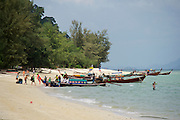 Thailand, Ko Hai. Arriving by ferry from Phuket, visitors need to change to a long tail boat to get to the beach.